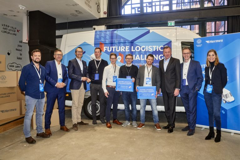 The winners of the Future Logistics Challenge 2019 with jury (v.l.n.r.): Artur Hasselbach (Smart Mobility & Transport Team VWN), Marco Schlüter (COO Hermes Germany), Kay Schiebur (Executive Board Member, Services, Otto Group), Jens-Philipp Klein (Atlantic Labs), Pascal Stech & Philipp Csernalabics (Co-Founder & CXO, Neohelden GmbH), Felix Meißgeier (Managing Director, VISCOPIC GmbH), Heinz-Jürgen Löw (Executive Board Member for Sales & Marketing, Volkswagen Commercial Vehicles), Kai Grünitz (CTO Autonomous Vehicles Volkswagen Commercial Vehicles), Susanne Brand (Head of Innovations, Hermes Europe GmbH)hermes europe; future logistics challenge; flc; volkswagen commercial vehicles; finals; winners; innovation; vehicles; mobility