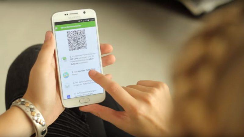 Rücksendung per Smartphone: Beim Mobilen Retourenschein reicht ein QR-Code für den Versand einer Retoure. Der Code wird im Hermes PaketShop gescannt, das Label vor Ort gedruckt. (Foto: Hermes).